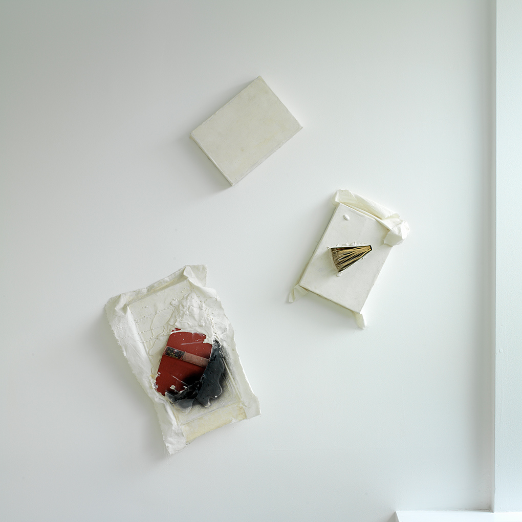 Book Relief Triad (2003/1959) Ink, plaster, books and white duck on wooden  boxes. Photo: Ken Adlard (FLAT TIME: 6)