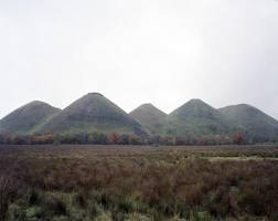 Five Sisters A view of the shale bings in West Calder. In 1976 Latham developed a feasibility study for his Scottish Office placement where he reconceived of the shale bings as process-sculptures (2012) C Print, 105 x 89cm (STUART WHIPPS:  0)